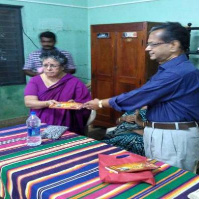 Dpf Published Book Presented To Trustee Of Madurai Guild Of Service Trusteesmt Indira