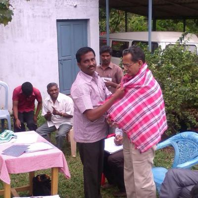 Hm Honouring Mr V.parthasarathy Dpf Managing Trustee With A Ponnadai