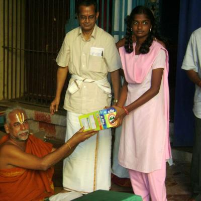 A Girl Student Receiving The Solar Lantern