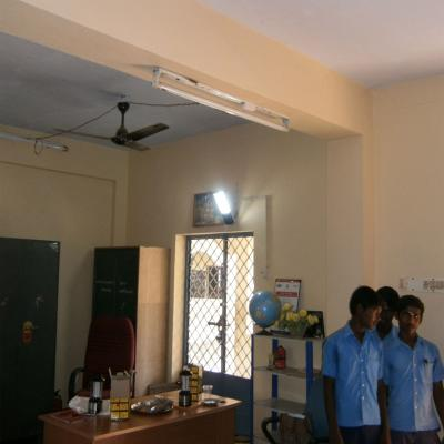 Students Below Solar Lamp In School Office