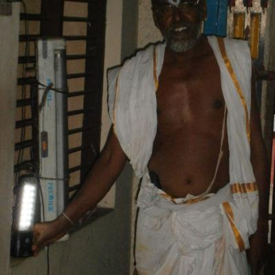 Temple Priest Displays The Solar Lantern