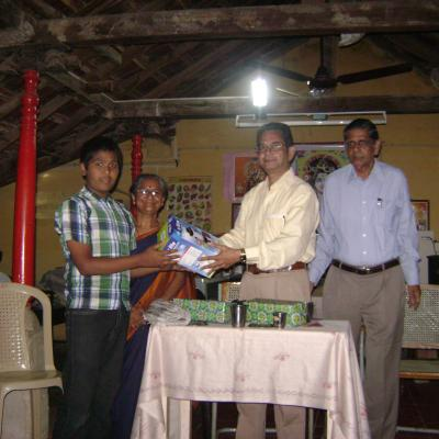 Presentation Of Solar Lantern To A Student
