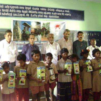 Dpf Selco And Other Guests Of The Function With Students Presented With Portable Solar Lanterns
