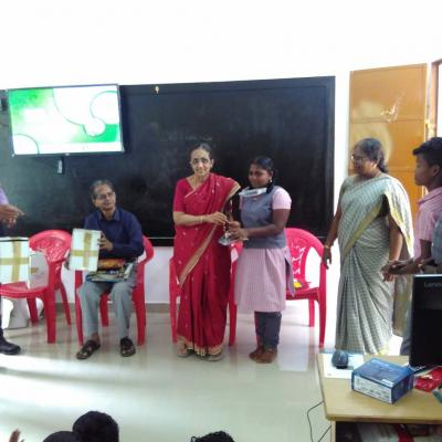 Nalini Parthasarathy Presenting Solar Lamp To A Student