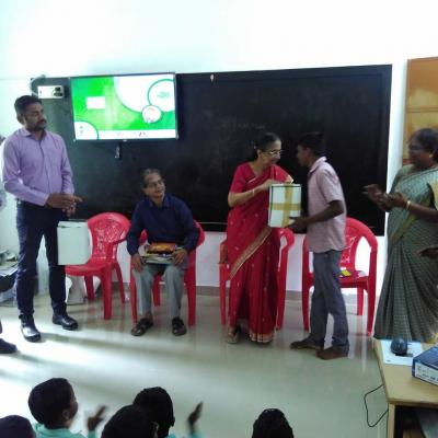 Solar Lamp Being Presented To A Boy Student