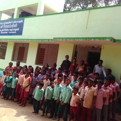 View Of The School With Students Lined Up