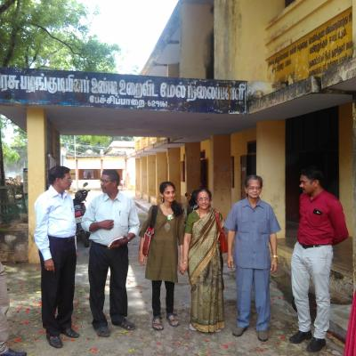 Hm Teacher With Guests In Front Of The School