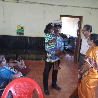With Mr Samson Tn Poilice Holding A Handicapped Child