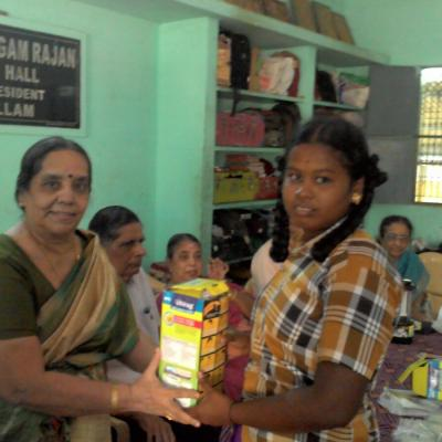 Mrs. Ramalakshmi Subramanian Wife Of S.g.subramanian Trustee Dpf Presenting The Solar Lantern