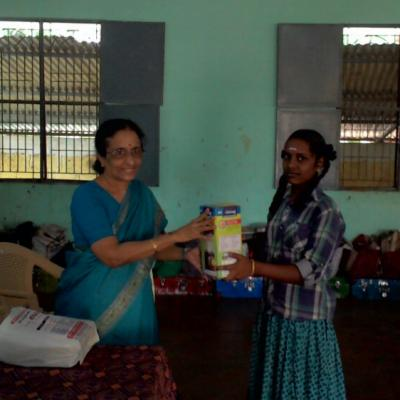 Smt. Nalini Partha Sarathy Handing Over The Solar Lantern